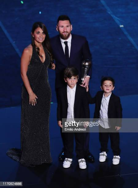 The Best FIFA Men's Player of the Year Lionel Messi poses with his family at the end of The Best FIFA Football Awards 2019 at the Teatro alla Scala...