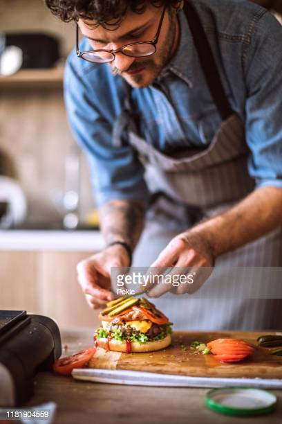 the best food is made with hard work - burger stock pictures, royalty-free photos & images