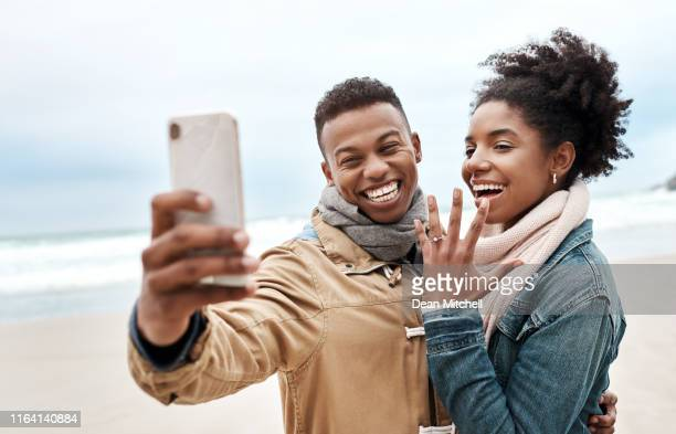 the best love stories happen on the beach - black women engagement rings stock pictures, royalty-free photos & images