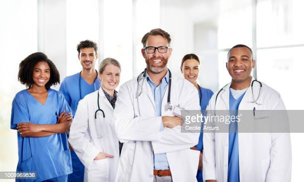 the best medical team a patient could hope for - group of doctors stock pictures, royalty-free photos & images