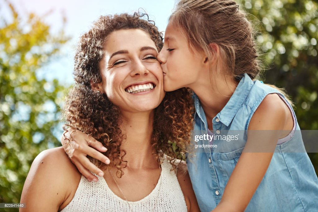The best mom deserves a big kiss : Stock Photo