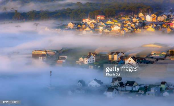 the best of picture, the city of fog with magic light and fog cover colors houses in valley at sunrise - south vietnam stock pictures, royalty-free photos & images
