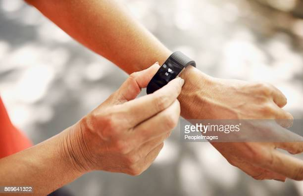 the best piece of tech for your wrist - checking sports stock pictures, royalty-free photos & images