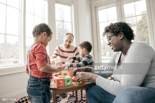 the best type of condo for a family with kids - white wife black baby stock photos and pictures