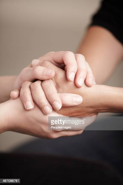 the best way to console is by simply being there.. - praying hands stock pictures, royalty-free photos & images