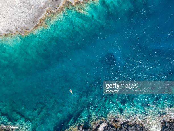the best way to relx on summer vacation - greek islands stock pictures, royalty-free photos & images