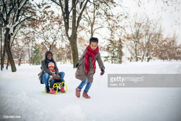 the best way to spend mothers day - winter family stock photos and pictures