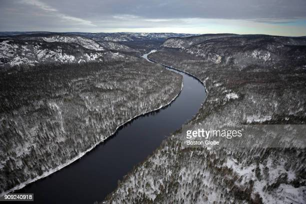 The Betsiamites River winds through forests and mountains up to HydroQuébec's Bersimis1 dam in Baie Comeau Québec on Jan 20 2018 Massachusetts bids...