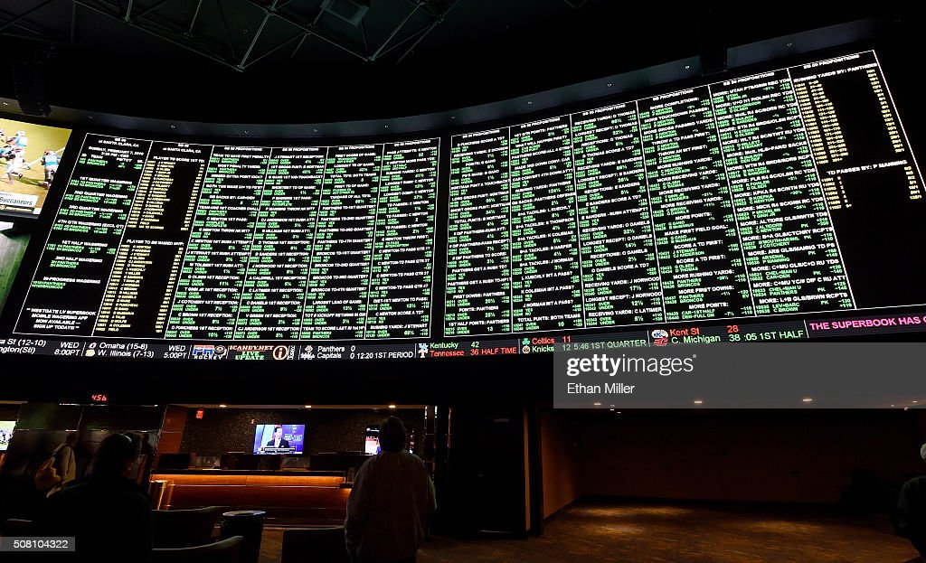 The betting line and some of the nearly 400 proposition bets for Super Bowl 50 between the Carolina Panthers and the Denver Broncos are displayed at the Race & Sports SuperBook at the Westgate Las Vegas Resort & Casino on February 2, 2016 in Las Vegas, Nevada. The newly renovated sports book has the world's largest indoor LED video wall with 4,488 square feet of HD video screens measuring 240 feet wide and 20 feet tall.