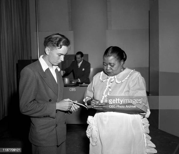 The Beulah Show a CBS Radio situation comedy August 27 1948 Hollywood CA Hattie McDaniel signs autograph for a fan