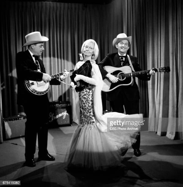 The Beverly Hillbillies The Beverly Hillbillies episode Flatt Clampett and Scruggs Pictured from left is banjo player Earl Scruggs Irene Ryan playing...