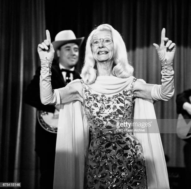 The Beverly Hillbillies The Beverly Hillbillies episode Flatt Clampett and Scruggs Pictured is Irene Ryan with Earl Scruggs in the background...