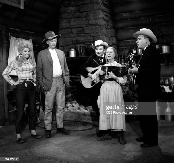 The Beverly Hillbillies The Beverly Hillbillies episode Flatt Clampett and Scruggs Pictured from left is Donna Douglas Buddy Ebsen guitar player...