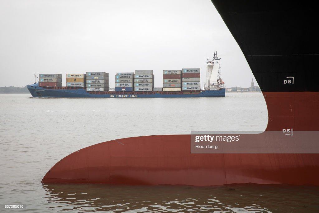 The BG Ireland container ship, operated by Jungerhans Maritime Services GmbH & Co KG, moves past the Express Rome container ship, operated by Danaos Shipping Co., at the Port of Felixstowe Ltd., a subsidiary of CK Hutchison Holdings Ltd. in Felixstowe, U.K., on Tuesday, Aug. 22, 2017. U.K. exporters are still reaping the benefits of a weaker pound, but they're not sure how long the boost will continue as the country gets closer to withdrawing from the European Union. Photographer: Simon Dawson/Bloomberg via Getty Images