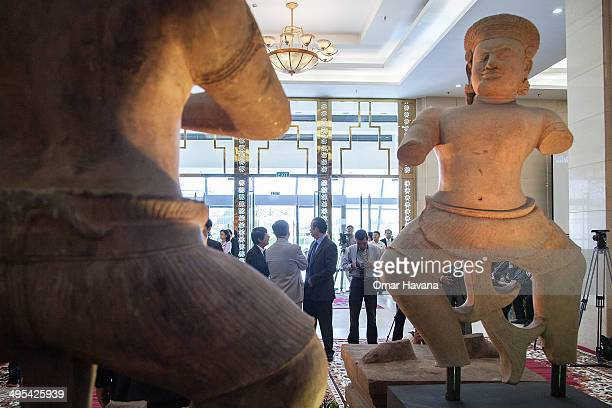 The Bhima and the Duryodhama statues are displayed during a ceremony to handover three statues back to Cambodia at the Council of Ministers on June 3...