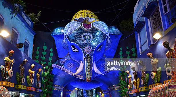 The Bhowanipur 75 Palli Durga Puja Pandal 40 feet ElephantThe entire elephant is created with cane and paper pulp along with the decorative arshi...