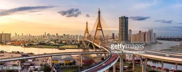 the bhumibol bridge (industrial ring road bridge) (bangkok, thailand) beautiful view at sunset, bangkok expressway top view, expressway and motorway at sunset aerial view from drone - bangkok stock pictures, royalty-free photos & images