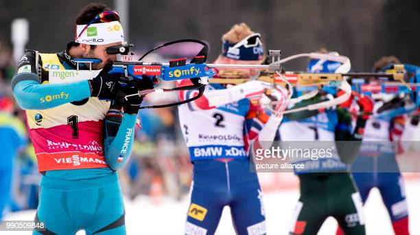 The biathletes Martin Fourcade from France Johannes Thingnes Boe from Norway and Simon Schempp from Germany during the men's mass start event of the...
