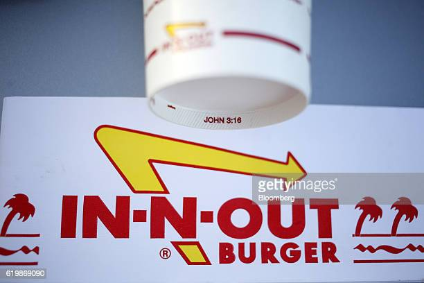 The Bible verse John 316 is printed on the bottom of a beverage cup from an InNOut Burger restaurant in Fort Worth Texas US on Monday Oct 24 2016...