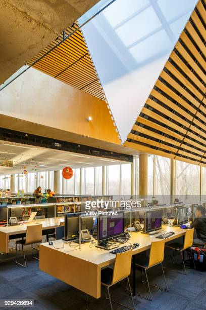 The Bibliothèque du Boisé Montreal Canada Architect Lemay Architectes 2013 The two floors are divided by the presence of a fold in the roof that...