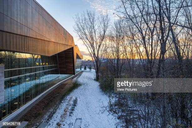 The Bibliothèque du Boisé Montreal Canada Architect Lemay Architectes 2013 View atop the ramp providing an aerial perspective suspended over the park