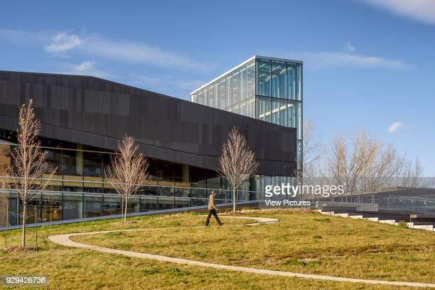 The Bibliothèque du Boisé Montreal Canada Architect Lemay Architectes 2013 View of the landscaping and front of the library with visible glass...