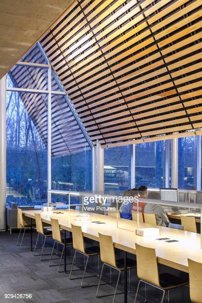 The Bibliothèque du Boisé Montreal Canada Architect Lemay Architectes 2013 The wooden shell extends to the exterior spaces in continuity with the...