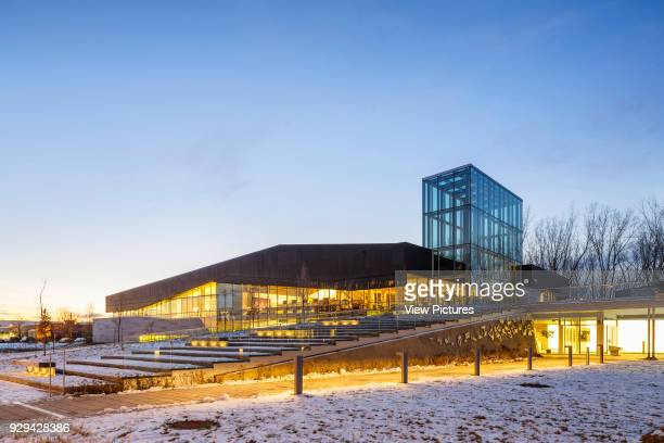 The Bibliothèque du Boisé Montreal Canada Architect Lemay Architectes 2013 Library exterior at dusk with a view of the main entrance the outdoor...