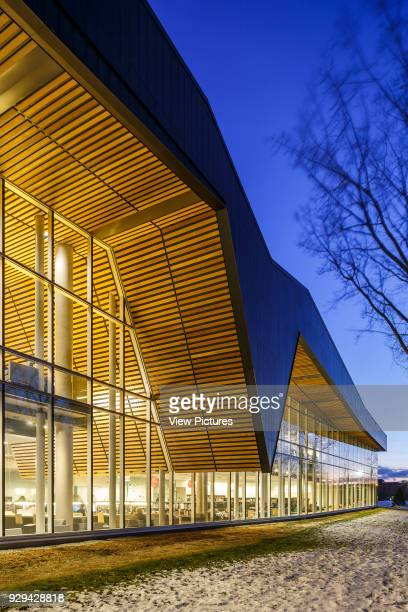 The Bibliothèque du Boisé Montreal Canada Architect Lemay Architectes 2013 The wooden shell projects over the exterior spaces in continuity with the...