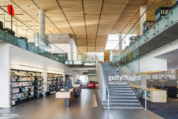 The Bibliothèque du Boisé Montreal Canada Architect Lemay Architectes 2013 Right at the centre of the building the great hall acts as a Roman plaza a...