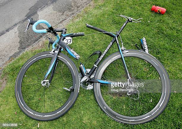 The bicycle of Sebastian Lang of Germany riding for Gerolsteiner lies broken on the side of the road after he crashed on the first lap during Stage...