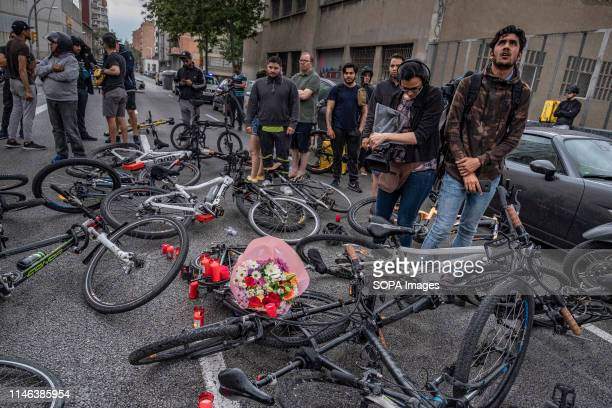 The bicycles of the Glovo delivery drivers are seen lying on the ground in front of one of the headquarters of the company during the protest A group...