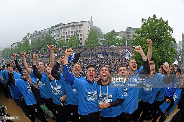 The Bielefeld team celebrates at the town hall after the Third League match between Arminia Bielefeld and Jahn Regensburg at Schueco Arena on May 16,...