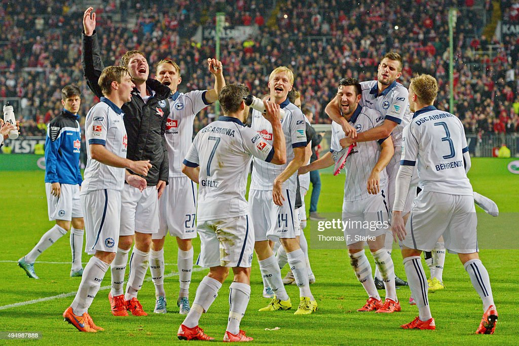 The Bielefeld team celebrates winning the Second Bundesliga match between 1. FC Kaiserslautern and Arminia Bielefeld at Fritz-Walter-Stadion on October 30, 2015 in Kaiserslautern, Germany.