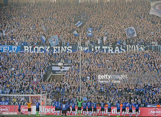 The Bielefeld team celebrates with the Bielefeld supporters after winning the Third League match between Arminia Bielefeld and Dynamo Dresden at...