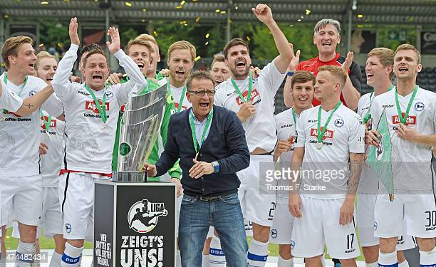 The Bielefelder team celebrates the Third League championship with head coach Norbert Meier after winning the Third League match between...