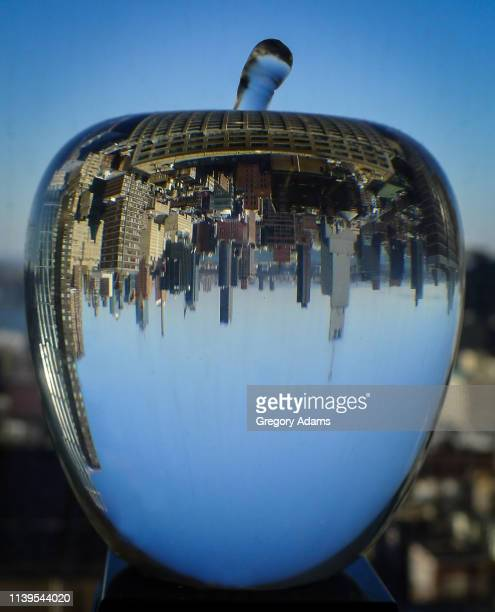 the big apple: new york skyline viewed through a crystal apple - blue balls pics stock pictures, royalty-free photos & images