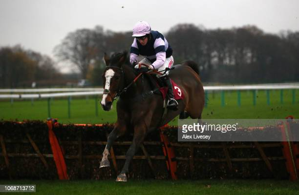 The Big Bite ridden by Noel Fehily clears the last fence on their way to victory in The Watch Racing UK In Stunning HD 'Introductory' Hurdle Race at...