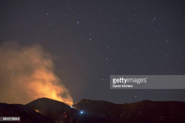 The Big Dipper constellation is seen over part of the Warm Fire on August 16 2015 in the Angeles National Forest north of Castaic California The...