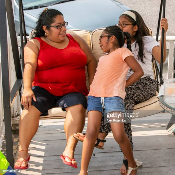 The Big Happy Latino Mexican American Family Resting At The Porch Of His House