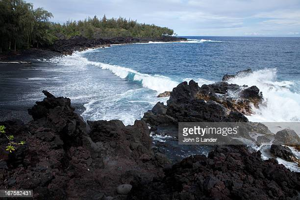 The Big Island landscape is always changing waves crashing into rocky shores and molten lava pouring into the ocean The Kalapana Black Sand Beach is...
