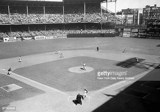 The big moment for the Yankees arrives in second inning as Yogi Berra follows through after swatting grand slam homer the fifth in World Series...