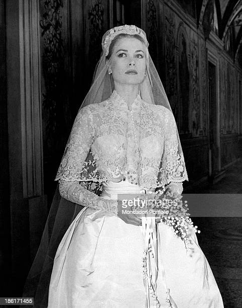 The big movie star Grace Kelly photographed in her bridal dress in a frescoed gallery within the Prince's Palace, just before the wedding ceremony...