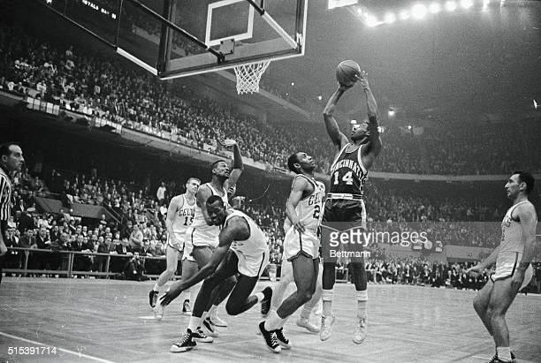 """The """"Big O"""", Oscar Robertson of the Cincinnati Royals, keeps three Boston Celtics players busy as he scores during first quarter action at Boston..."""