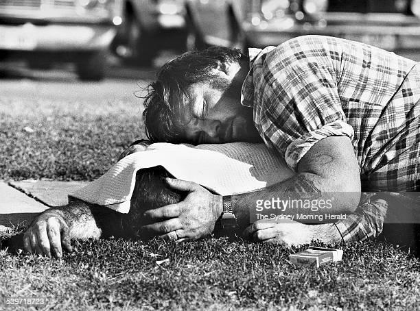 The Big Picture A man lies over his dead brother after the 1984 Fathers' Day Massacre in Milperra A thousand people were in the Viking Tavern car...