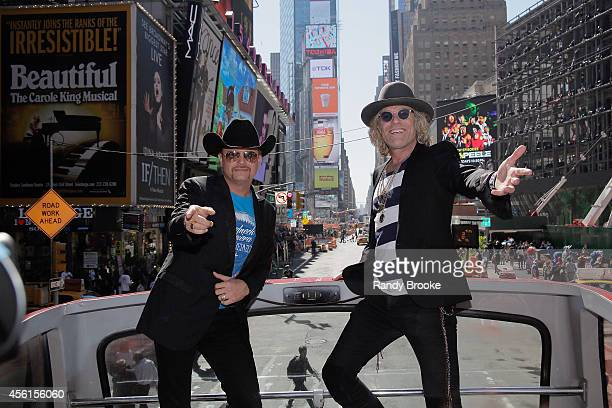 The Big Rich duo John Rich and Big Kenny greet Times Square aboard the Ride of Fame at Pier 78 on September 26 2014 in New York City