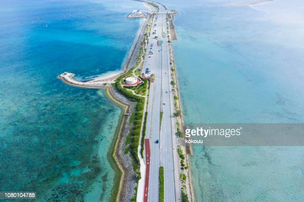 the big road surrounded by the sea is beautifully paved - land feature stock pictures, royalty-free photos & images