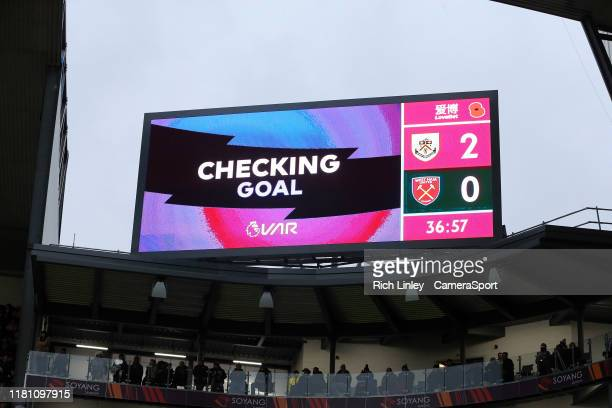 The big screen at Turf Moor indicates Chris Woods' first half headed goal is being checked via VAR review during the Premier League match between...