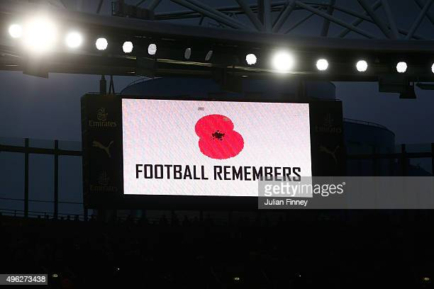 The big screen displays a poppy prior to the Barclays Premier League match between Arsenal and Tottenham Hotspur at the Emirates Stadium on November...