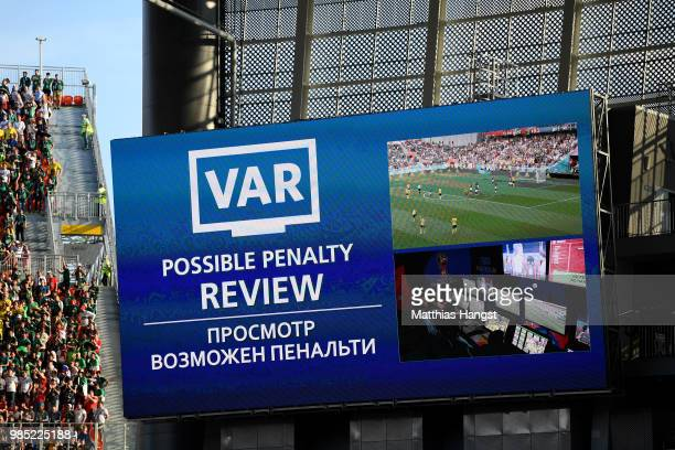 The big screen displays a VAR review for a possible penalty during the 2018 FIFA World Cup Russia group F match between Mexico and Sweden at...